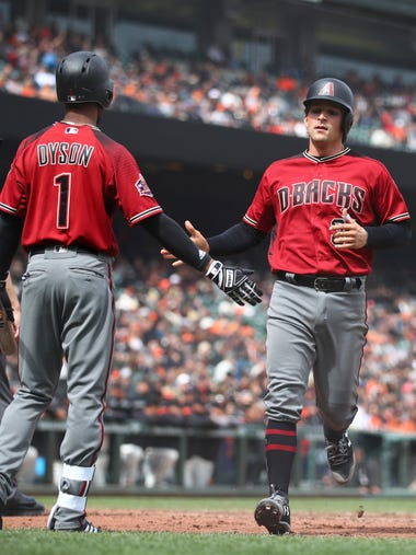 Arizona Diamondbacks' John Ryan Murphy, right, is congratulated