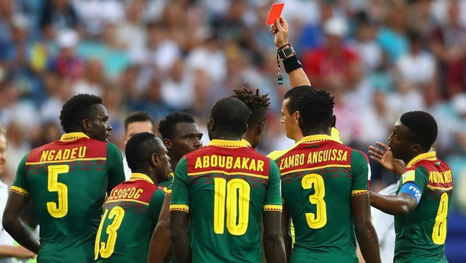 Emest Mabouka of Cameroon is shown a red card by referee Wilmar Roldan after advice from the VAR during the  Confederations Cup match between Germany and Cameroon at Fisht Olympic Stadium  in Sochi, Russia.
