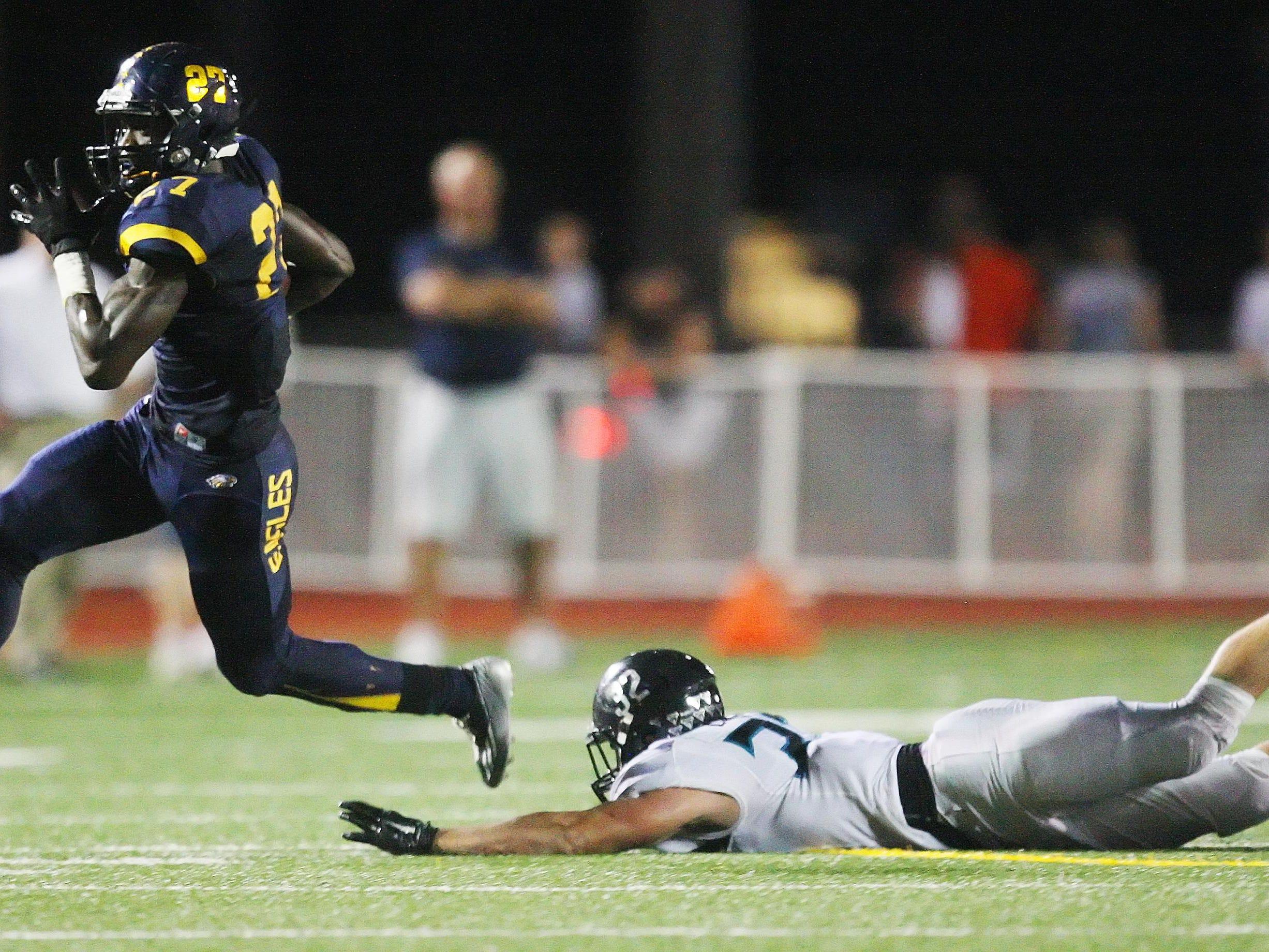 Naples High School's Carlin Fils-Aime scores a touchdown against Gulf Coast on Friday at Naples High School.