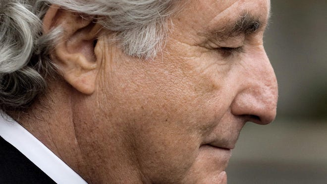 A file picture taken in March 2009 shows disgraced financier Bernard Madoff leaving federal court following a hearing in New York, New York, USA.