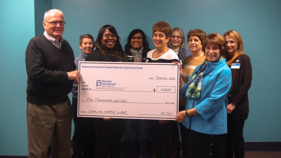 At a brief ceremony at Planned Parenthood in Mount Auburn, members of the Cincinnati fund of the National Council of Jewish Women present the group's last grant, $5,000. From left: Jerry Lawson, president and chief executive officer of Planned Parenthood, Ellen Doyne of the National Council of Jewish Women; Stephanie Dodd, manager of the Mount Auburn health center; Sher'rie Brown, Planned Parenthood director of clinical services;  local council members Marlene Ostrow, Mauri Willis, Andrea Herzig and Penny Pensak.
