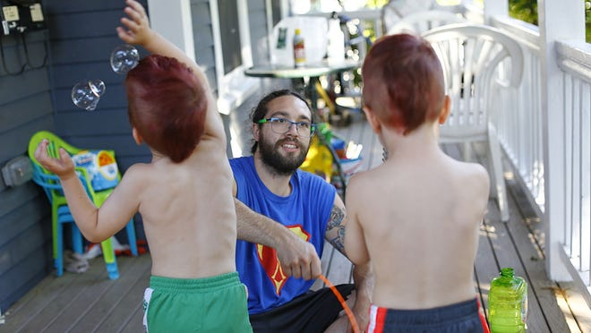 Dad Kenny Coy with his four year old twin sons Casper in the black trunks and Niklaus in the green of Quincy on Thursday June 18, 2020 Greg Derr/The Patriot Ledger