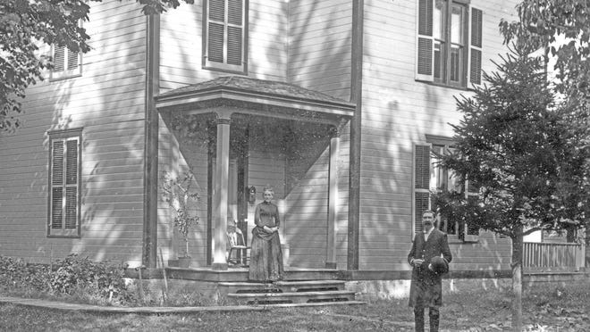 The Rev. W.T. Campbell and his first wife, Rachel, stand in front of the Second Presbyterian Church manse at 818 E. First Ave., not long before Rachel's death.