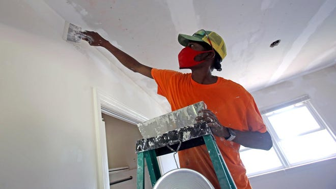 Benny Fair works inside a home at 117 Victor Drive in Boiling Springs. He is working for Experience Capital LLC and Jennings Real Estate Group LLC, as a contractor to rehabilitate homes that once were seen as dilapidated or outdated.