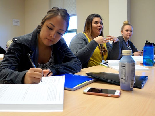A group of NMSU students write in journals and participate in a discussion during Jeremy Rutherford's Introduction to Mindfulness undergraduate class in O'Donnell Hall.