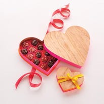 Small candies work best in these boxes because they fit snugly inside the shapes. Try hot cinnamon candies, candy-coated chocolates, mini jelly beans and tiny hearts.