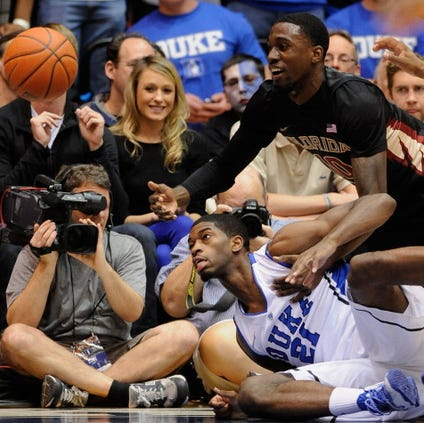 DURHAM, NC - JANUARY 25:  Amile Jefferson #21 of the Duke Blue Devils battles Okaro White #10 of the Florida State Seminoles for a loose ball on the baseline during their game at Cameron Indoor Stadium on January 25, 2014 in Durham, North Carolina. Duke won 78-56.  (Photo by Grant Halverson/Getty Images)