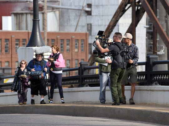 """Production crew members film a scene for the faith-based movie """"The Reliant"""" on the Y Bridge in Zanesville."""