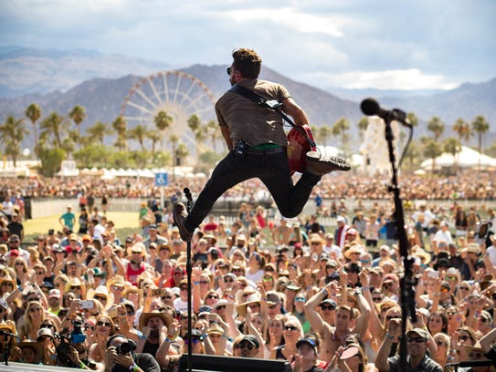 Old Dominion's Matthew Ramsey leaps during the band's