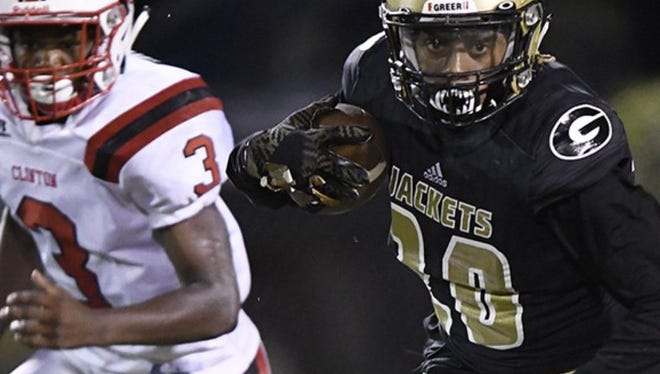 Junior running back Quay White, right, and the Greer Yellow Jackets will host Daniel Friday night at Dooley Field.