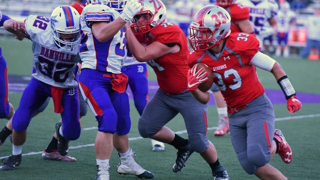 SJCC's Ross Snyder caught a key touchdown pass from Spencer Harrison in a win over Danville.