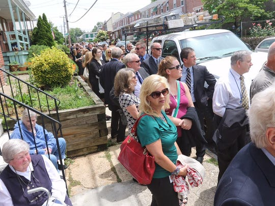 Mourners gather at St. Anthony of Padua Church in Wilmington for a wake for Beau Biden on Friday. The memorial marked the second of three days of mourning for Biden, 46, who died of brain cancer.
