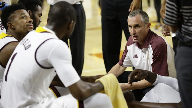 ASU head coach Bobby Hurley huddles with his players against UC Santa Cruz in the second half on Nov. 3, 2016 in Tempe, Ariz.