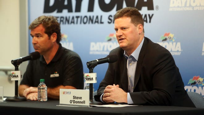 Feb 23, 2013; Daytona Beach, FL, USA; Daytona International Speedway president Joie Chitwood (left) and NASCAR vice president of operations Steve O'Donnell speak at a press conference after the DRIVE4COPD 300 at Daytona International Speedway.
