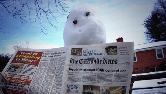 This snowman, photographed Feb. 13, 2014, never misses an edition of The Greenville News.