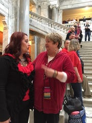 Kelly Gunning, right, greets advocates fighting to overturn the veto of Tim's Law on Wednesday in the state legislature.