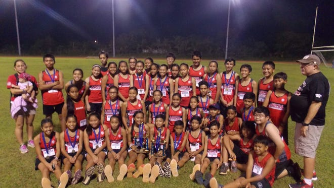 The Agueda Johnston Middle School girls and boys team took the Guam Department of Education Interscholastic Middle School Cross-Country League title after going undefeated in the season. The team poses with their trophies and medals after the All-Island Meet Thursday at Okkodo High School.