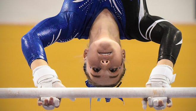 Sartell's Abby Weber competes on the uneven parallel bars during the team Class A championships Friday, Feb. 23, at the Maturi Pavilion in Minneapolis.