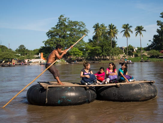 Migrants cross into Mexico from Guatemala using a raft