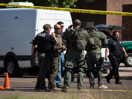 Glendale SWAT team officers and Phoenix police line
