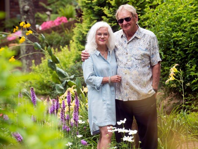 Sandi Burdick and Tom Boyd stand in the Bird House
