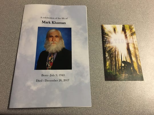 A program and card from the funeral of Elder High School teacher Mark Klusman. The service was on Jan. 3, 2018.