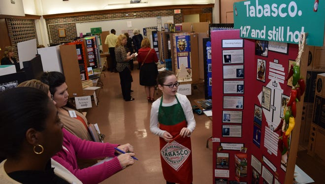 Madelynn Dunn, a Caroline Dormon Junior High School seventh-grader, talks about Tabasco as she presents her project to judges at the Rapides Parish Social Studies Fair held Thursday.