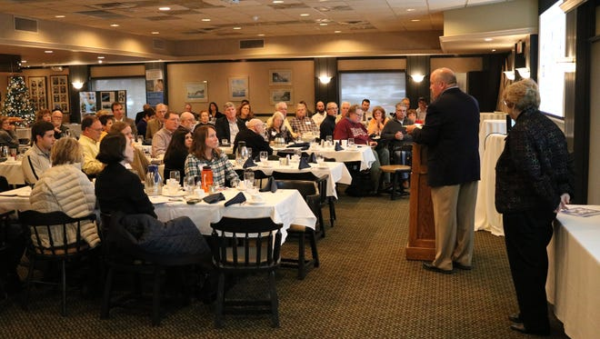 Jim Stouffer, of the Lake Erie Foundation, speaks during the organization's annual forum at the Catawba Island Club on Friday.