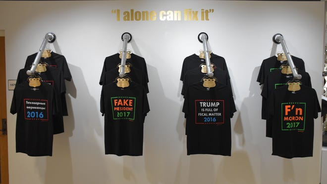 A collection of homemade, anti-Donald Trump T-shirts made by Douglas Reiser hang at the art teacher's anti-Trump art installation at Pensacola State College.