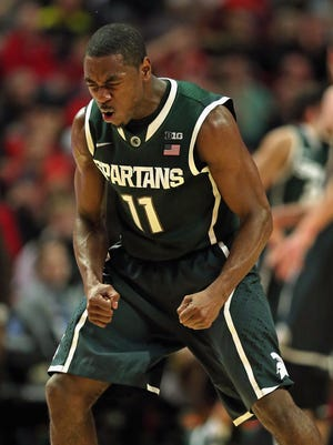 Lourawls Nairn Jr. of the Michigan State Spartans celebrates a teammate's three-point shot against the Maryland Terrapins during the semifinal round of the 2015 Big Ten tournament at the United Center on March 14, 2015 in Chicago, Illinois.