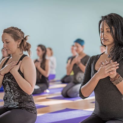 Asheville Yoga Center will donate 10 percent of class