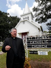 Rev. Greg Plata, speaks  outside the St. Thomas Catholic Church that he pastors Friday, Aug. 26, 2016 in Lexington, Miss.,  about the community loss with the murders of Sister Margaret Held and Sister Paula Merrill, both nurse practitioners in the town.