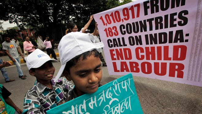 Indian children and freed child laborers participate in a march in New Delhi, India, in Aug.