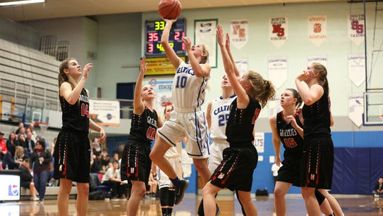 McNary sophomore Kailey Doubt (10) goes up for a basket