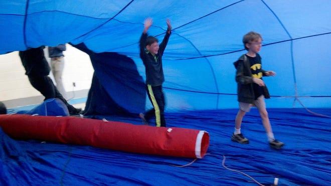Farrand Elementary students enter the hot air balloon.
