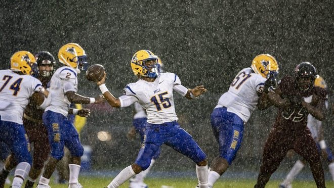 In this 2019 photo, Miami Northwestern's quarterback looks to pass against Palm Beach Central in Wellington. The School Board of Miami-Dade County voted unanimously Wednesday afternoon to explore withdrawing its public schools from the FHSAA.