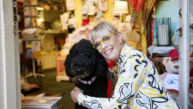 Sherry Frankel always has her standard poodle, Dash, at her store, Sherry Frankel's Melangerie in the Via Amore.