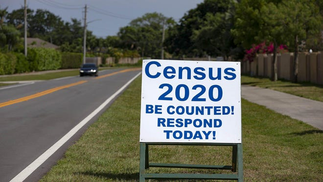Signs along Wellington Trace encourage residents in Wellington to fill out their Census 2020 forms in Wellington, Tuesday, April 21, 2020.