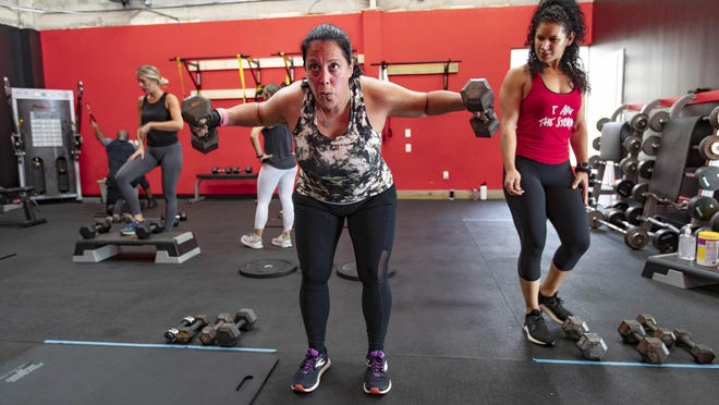Tracy Accettulli, Wellington, works out at Cat 5 Fitness as trainer Mirca Colon, looks on Wellington, May 18, 2020.
