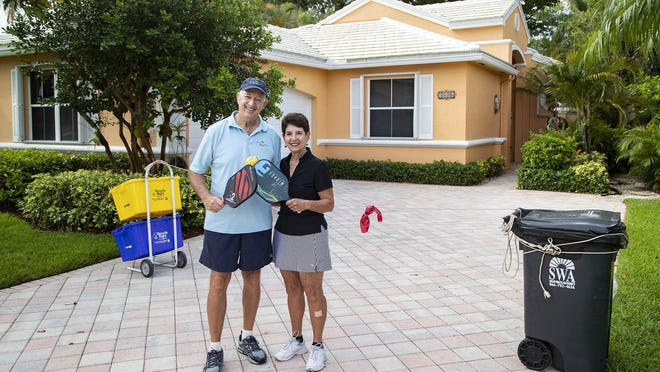 Marty and Harriet Ross created a pickleball court in their driveway to stay busy during the coronavirus pandemic in Wellington, May 19, 2020.