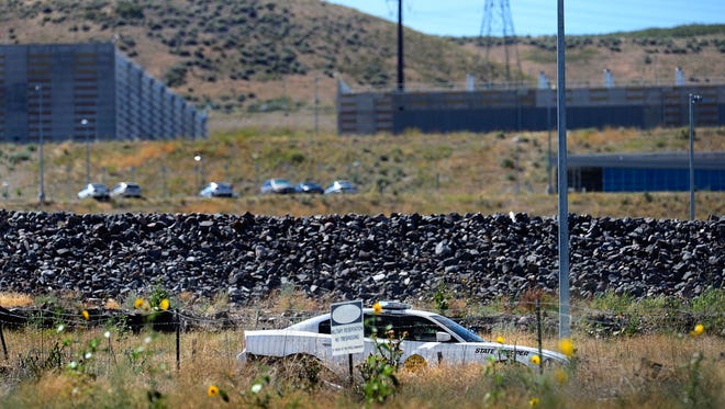 A Utah Highway Patrol trooper sits at the entrance to the National Security Agency's  Utah Data Center, Thursday, July 23, 2015.