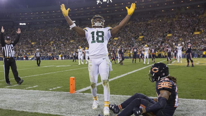 Packers wide receiver Randall Cobb celebrates after scoring a touchdown while being covered by Bears cornerback Cre'von LeBlanc in the fourth quarter Thursday night at Lambeau Field.