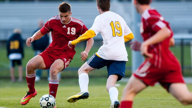 Port Huron senior Will Kriewall steals the ball from Port Huron Northern sophomore Nathan Tomlinson during a soccer game Thursday at Port Huron Northern.