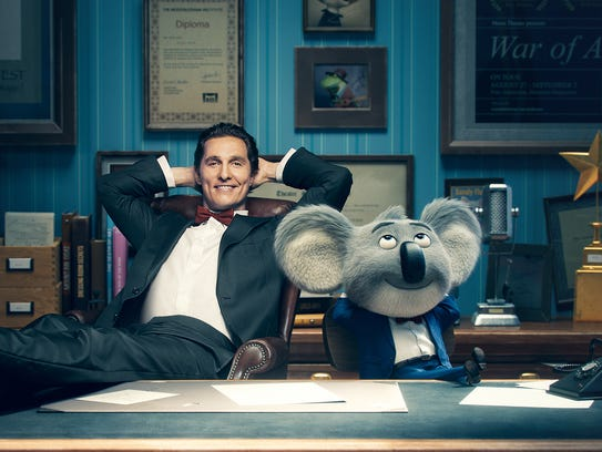 Matthew McConaughey with his character, Buster Moon,