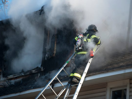 Officials respond to a house fire on W. Bettlewood
