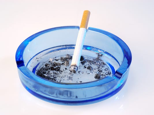 Cigarette burning in ashtray