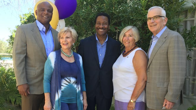 NFL Hall of Famer Warren Moon, Co-chair Kay deMars, Emmy Award winner Steve Pool, Co-chair Sandy Dyer, UW Provost and Executive Vice President Gerald Baldasty.