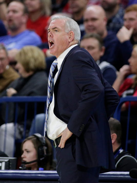 BYU coach Dave Rose shouts to his team during the first half of an NCAA college basketball game against Gonzaga in Spokane, Wash., Saturday, Feb. 3, 2018. (AP Photo/Young Kwak)
