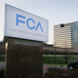 The Fiat Chrysler Automobiles sign is seen at Chrysler World Headquarters in Auburn Hills, Mich.