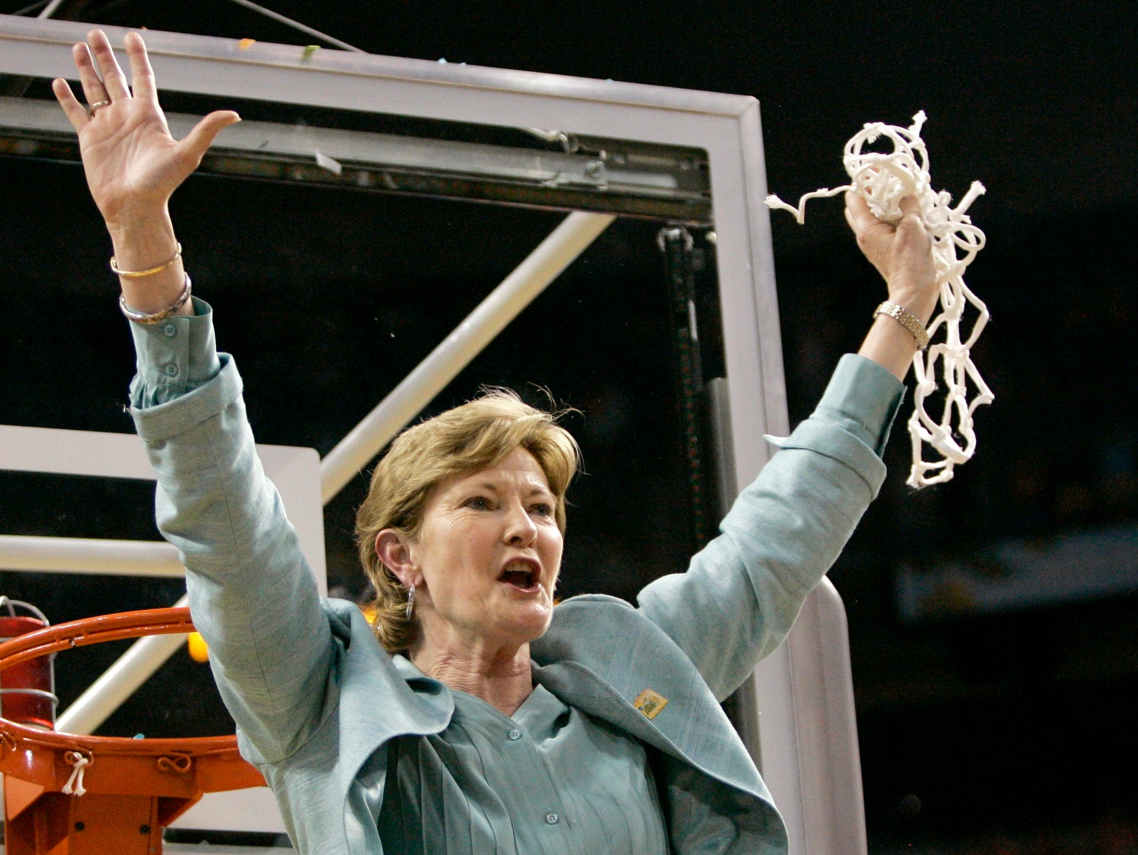 Pat Summitt holds up the net as her son, Tyler, looks on after Tennessee beat Stanford 64-48 to win its eighth national women's basketball championship, at the NCAA women's basketball championship on April 8, 2008, in Tampa, Fla.